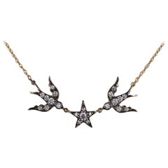 Blackbird and the Snow diamond bird star swallow necklace