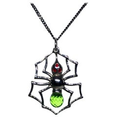 Blackened Silver Spider Pendant with Cultured Green Sapphire, and Red Zirconia