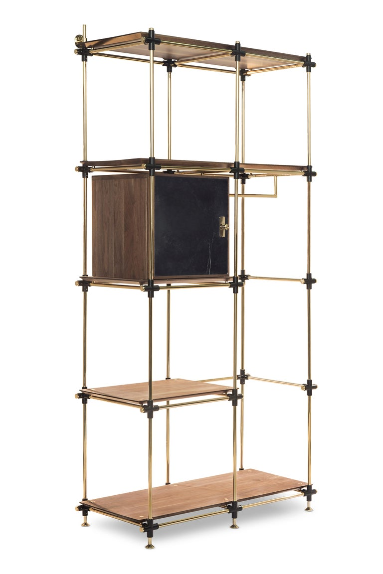 Blake is a modular bookcase system easily customizable to any measures needed. The custom made nero marquina marble doors have a lightweight core that conveys solidity. This glaring modular brass and walnut wood structure creates a stunning