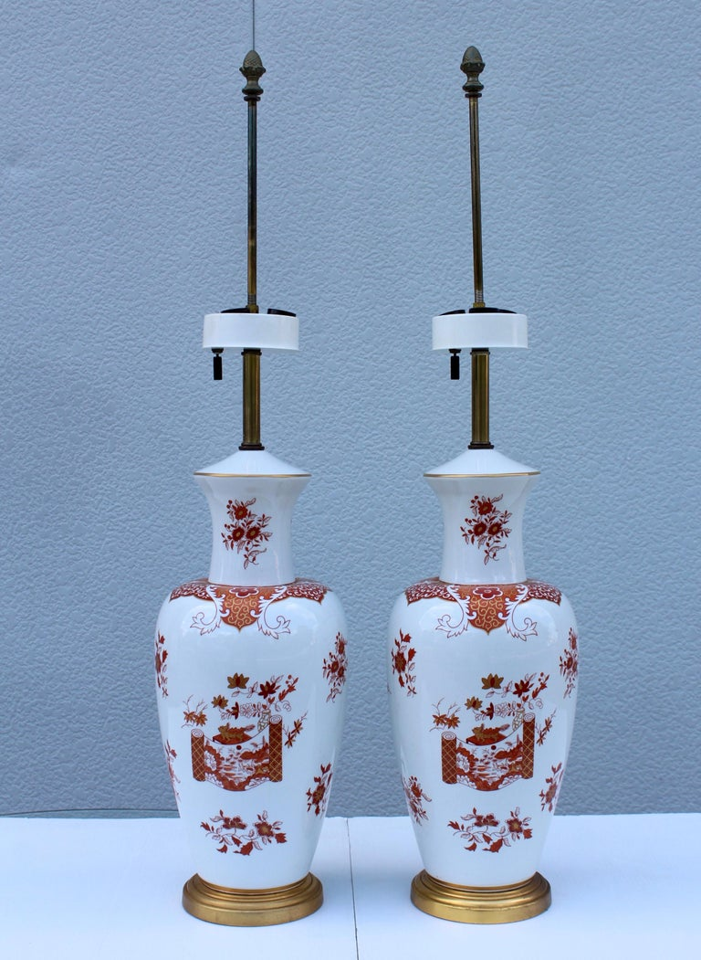 Stunning pair of 1950s Blanc De Chine porcelain large table lamps with hand painted detail and gilt base.