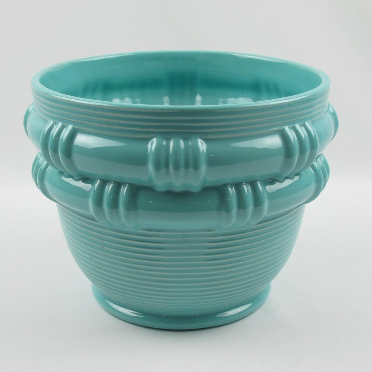 Very stylish 1950s ceramic vase or planter by ceramicist Blanche Letalle for Faiencerie Saint-Clement. Lovely turquoise glaze with basketry pattern. Blanche Letalle was a recognized French designer-ceramicist who worked for Faiencerie Saint-Clement