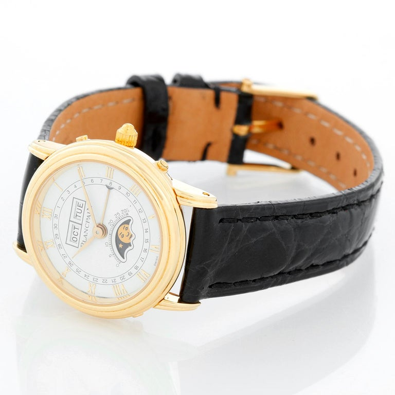 Blancpain 18K Yellow Gold Moonphase Ladies Watch - Manual winding; Day, Date, and Moonphase. 18K Yellow gold case with (26mm). White dial with Roman numerals; Day, Date, and Moonphase. Brown Strap with gold Blancpain tang buckle. Pre-owned with