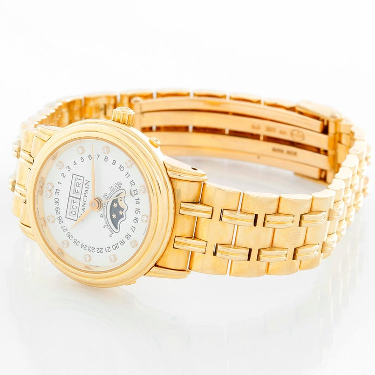 Blancpain 18K Yellow Gold Villeret Moonphase Ladies Watch - Automatic. 18K Yellow gold ( 26 mm). White dial with moonphase and full calendar complications. 18K Yellow gold bracelet; will fit up to a 6 inch wrist. Pre-owned with Blancpain box.