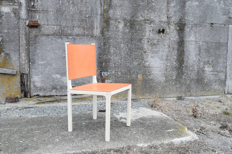 This is a clean and simple dining chair, crafted of bleached maple and featuring a seat and back of natural skirting leather. The chair is light, sturdy, and very comfortable. The thick veg tan leather molds to your body as you sit, providing just