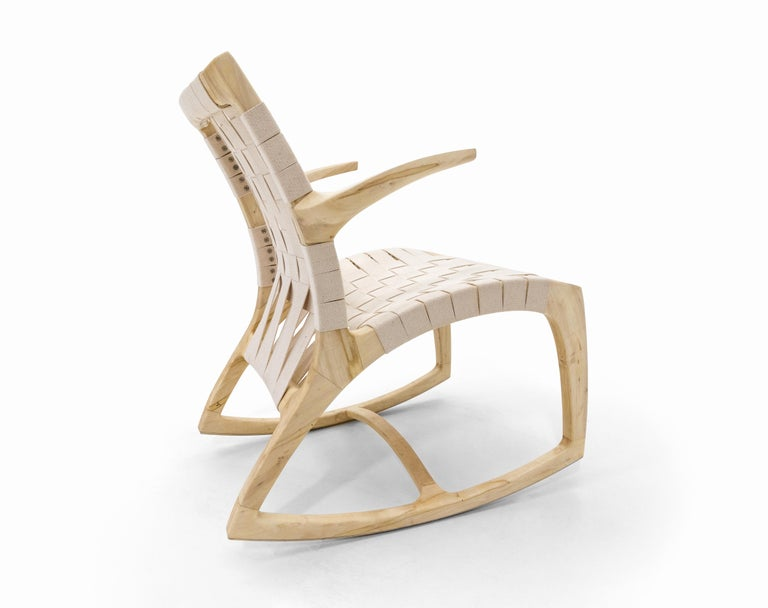 Rocking chairs have been a focus of furniture designers for centuries, quite simply because they are difficult to make. Here's one where comfort and design meet right in the middle. The Luna Rocker was designed by Martin Goebel in 2013. Heavily