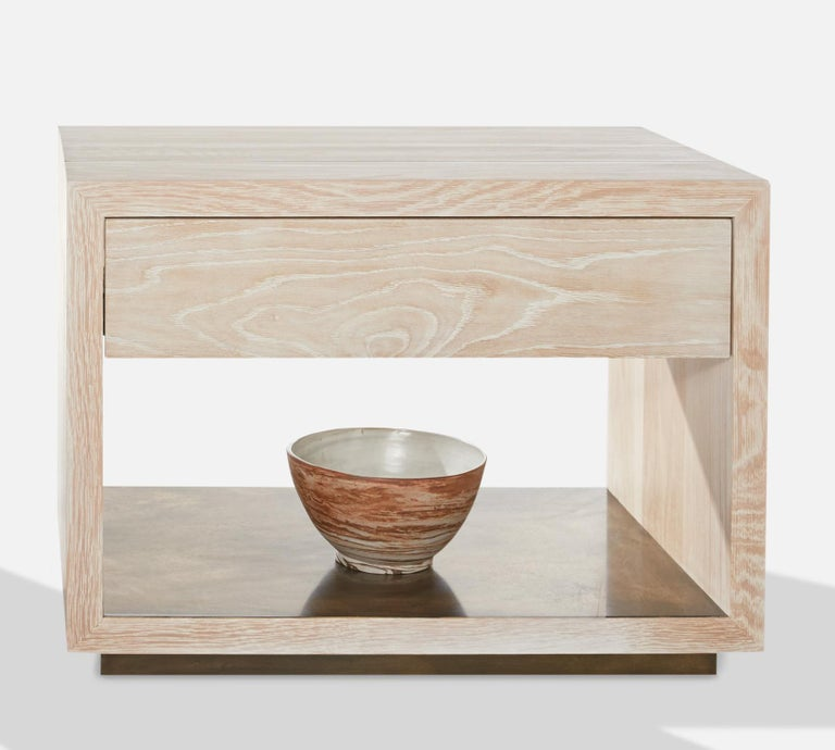 Bleached white oak with antiqued brass shelf and waterfall inlay. Made in the USA by Casey McCafferty.  Available finishes: Oiled black walnut, oiled white oak, bleached white oak, charred ash, oxidized maple.