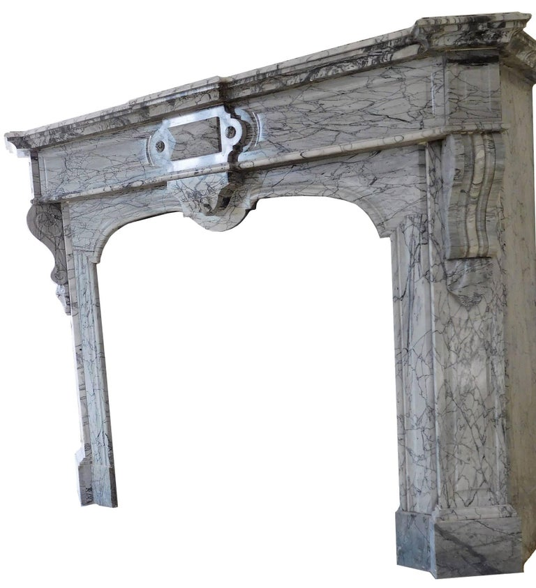 A Napoléon III chimneypiece, finely shaped in soft-toned grey-bleu, so named