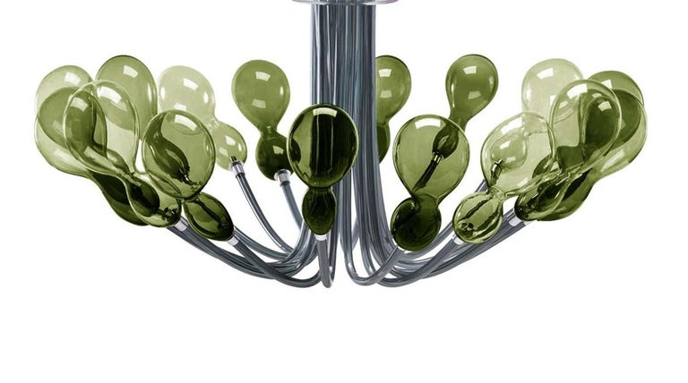 Part of the Blob collection designed by Karim Rashid in 2014 and boasting a light and dynamic look that is sophisticated and modern, this chandelier is a striking addition to a contemporary entryway, living room or dining room. The sixteen lights