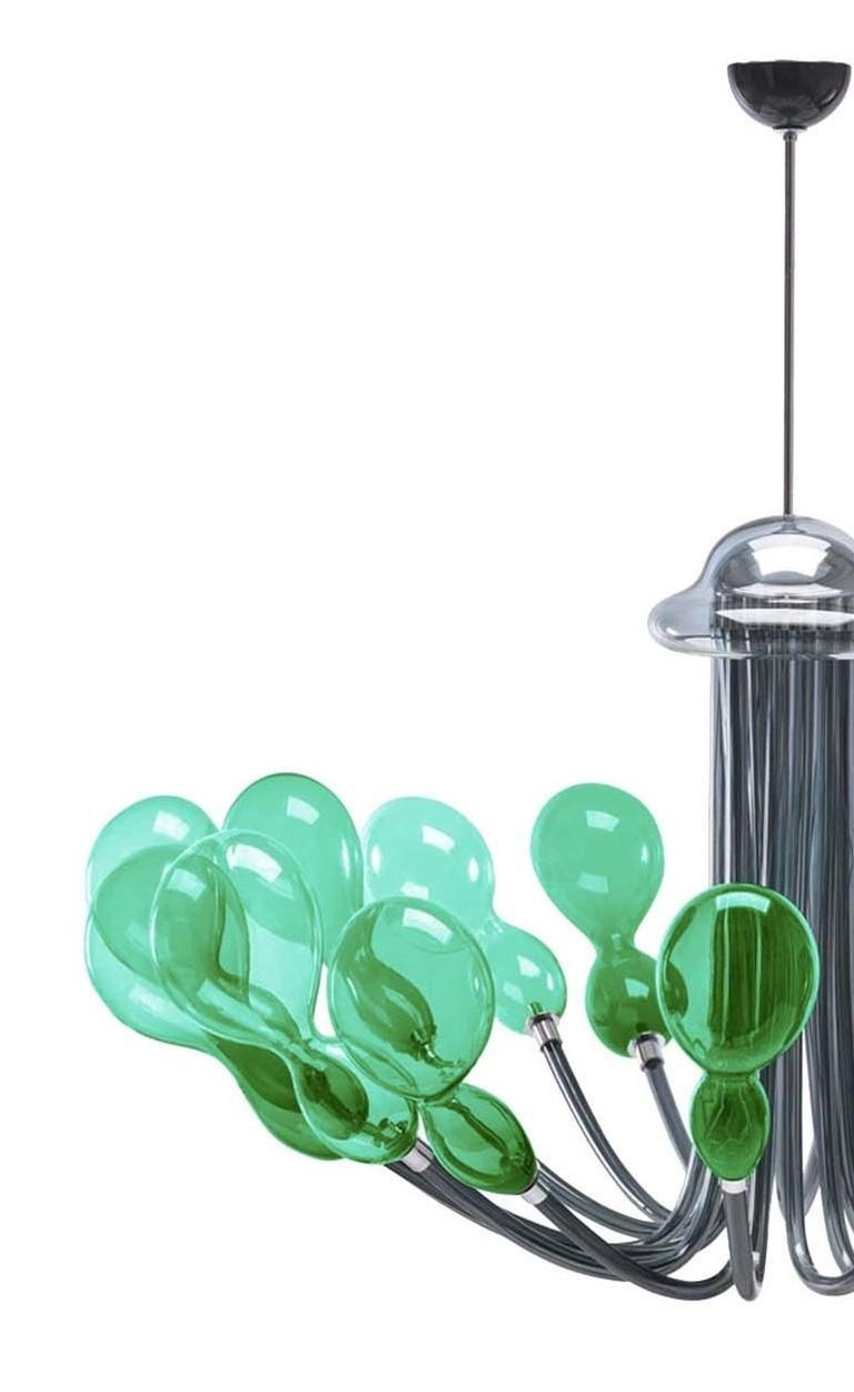 Elegant and modern, this chandelier will add a unique ambiance to a contemporary home, where it will make a statement in an entryway, in a living room or above a dining table. The 16 lights are set in a series of elegant balloon-shaped Murano glass