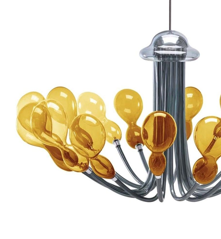 Combining exquisite craftsmanship with modern aesthetic, this chandelier will add a sense of lightness and elegance to any contemporary home. It was designed by Karim Rashid in 2014 and boasts 16 bobeches of mouth-blown Murano glass resembling