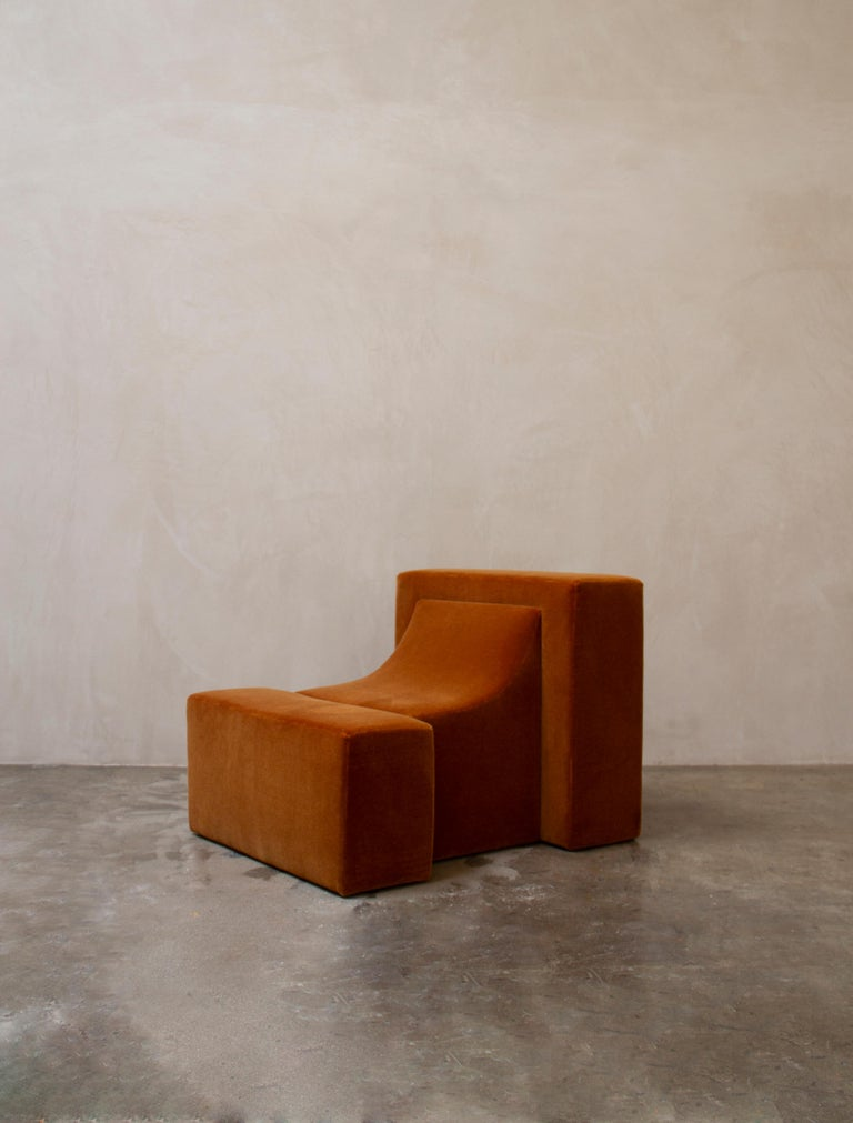 Block chair by Estudio Persona Dimensions: W 76.2 x D 91.44 x H 66.04 cm Materials: Mohair Fabric  Upholstered lounge chair. Shown in mohair fabric. Also available in COM. Customizations available.  Estudio Persona was created by Emiliana