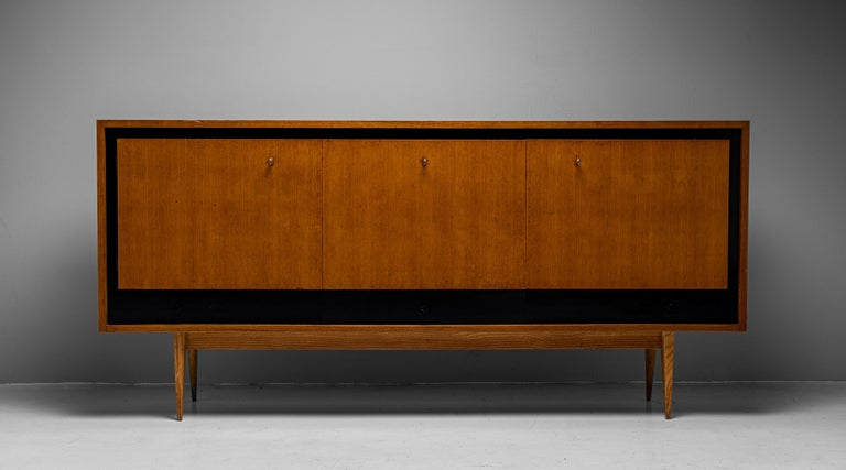 """Blonde Ash Enfilade by Charles Ramos  France circa 1950  Constructed in blonde ash with ebonised detailing. The two side compartments open up while the center has a drop down door.  Measures: 78.5""""W x 17.75""""D x 36.75""""H."""