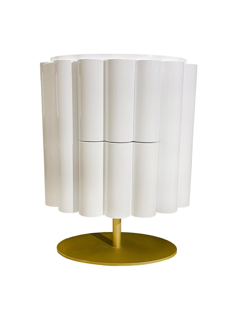 Give your bedroom an instant style injection with this beautiful Postmodern inspired bedside table. With grooved drawer fronts, eye-catching geometric body and contrasting brass-coated leg; it has an effortlessly chic appearance. It features a