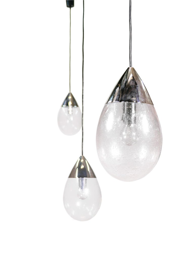 Vintage handblown glass and chrome drop light manufactured by Limburg, Germany in the 1970s. Top-quality workmanship, the suspension with steel wire. Good condition, no defects, but it may show slight traces of use. Measures: Height 14 in. / 36