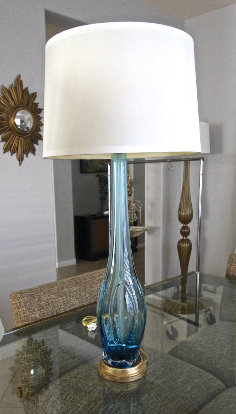 A single tall Murano Italian hand blown clear and blue glass organic shaped table lamp by Seguso. Mounted on newer giltwood base. Newly wired for US with new solid brass fittings and 3 way socket.