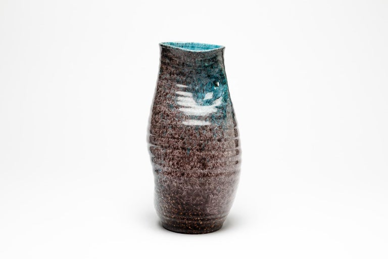 Accolay  Elegant freeform ceramic vase by Accolay  Signed under the base  Original perfect conditions  Decorative blue and grey ceramic glazes colors  Measures: Height 29cm, large 16cm.