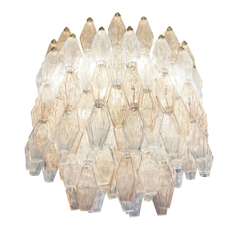Midcentury chandelier by Venini made with their iconic poliedri Murano glasses. The glasses are a mix of light blue ones and light rose' ones mounted on a white lacquered frame. Ready to hang on a chain.  Condition: Excellent vintage condition,
