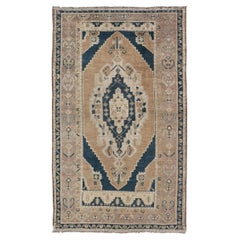 Blue and Tan Oushak Vintage Rug from Turkey with Geometric Layered Medallion