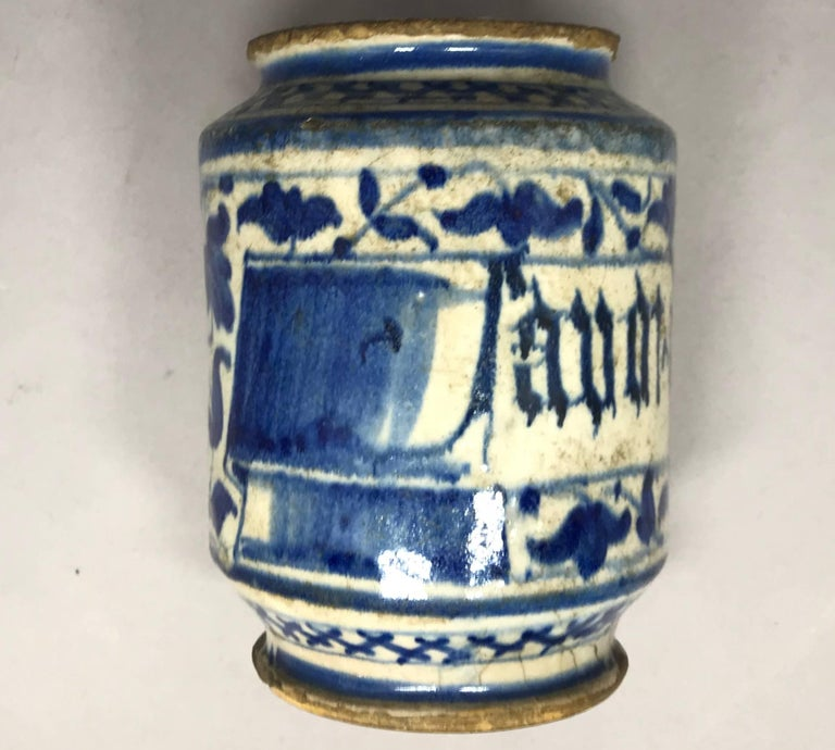 Blue and white Albarello vase. Fine smaller early Italian pottery pharmacy jar in rich blue and off-white scrolling patterned floral and inscription; design based on Persian originals, Italy, early 17th century. Dimensions: 4