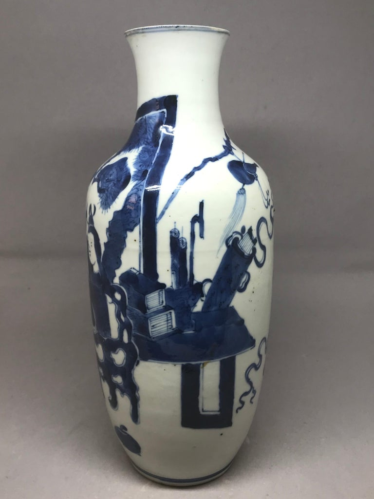 Blue and white Chinese vase. Qing era vase modeled in two sections of baluster form in white paste with strong blue figures and accoutrements, China, mid-19th century. Dimensions: 11.38