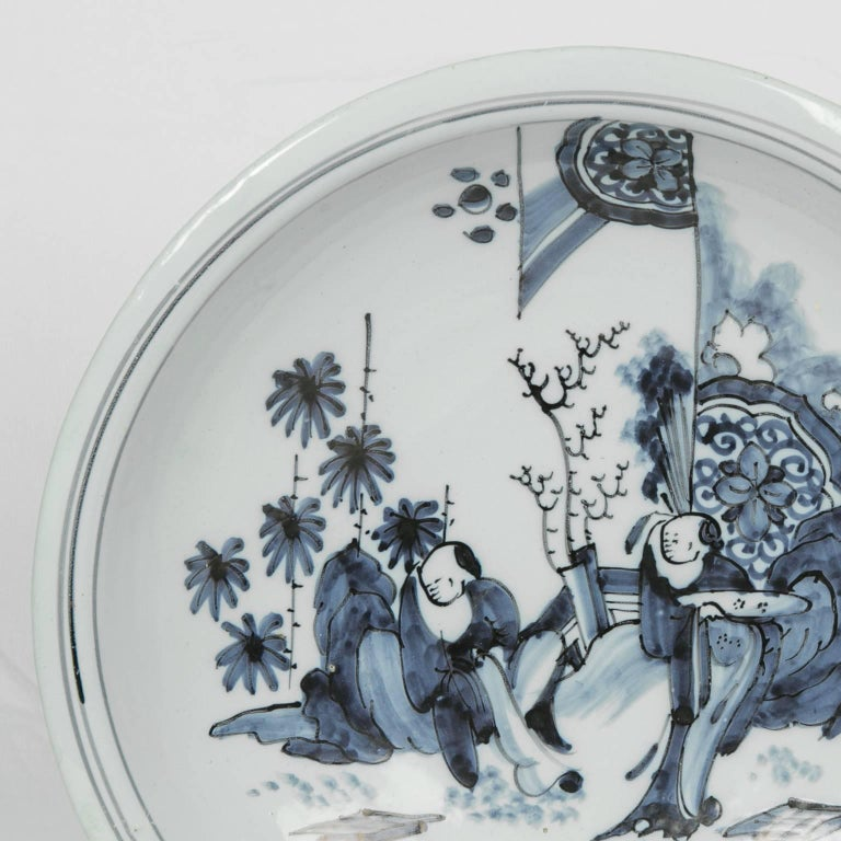 Chinoiserie Blue and White Delft Charger with Chinese Inspired Scene Made circa 1640-1650 For Sale