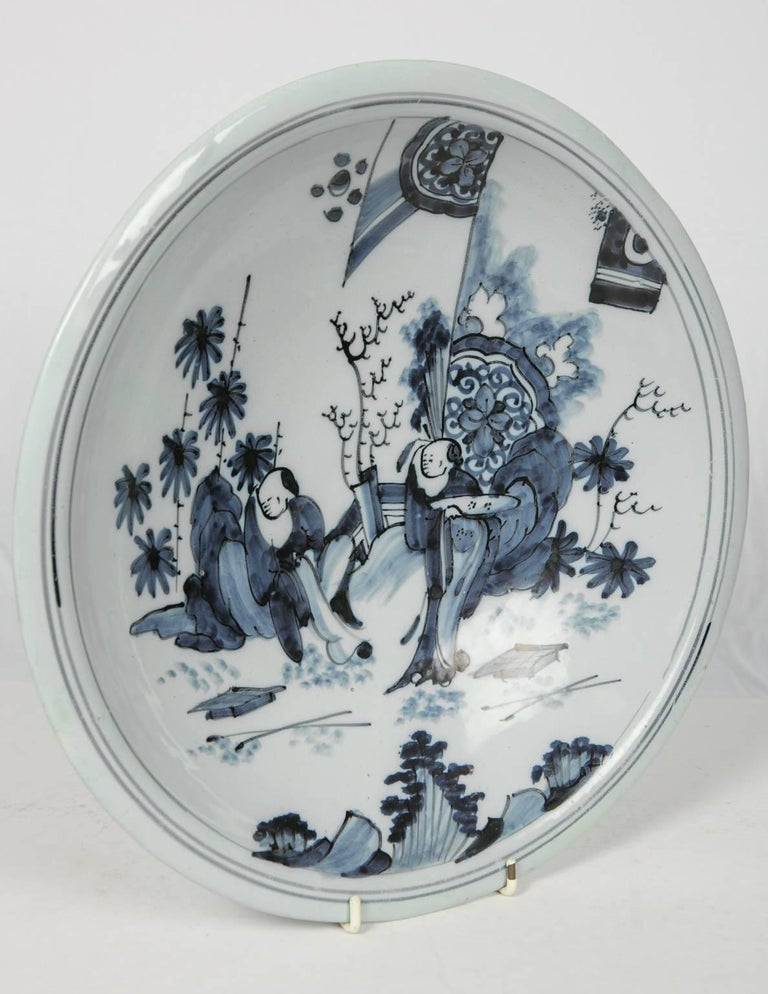 Dutch Blue and White Delft Charger with Chinese Inspired Scene Made circa 1640-1650 For Sale