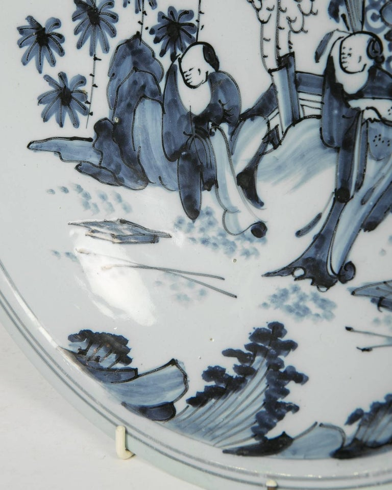 Hand-Painted Blue and White Delft Charger with Chinese Inspired Scene Made circa 1640-1650 For Sale