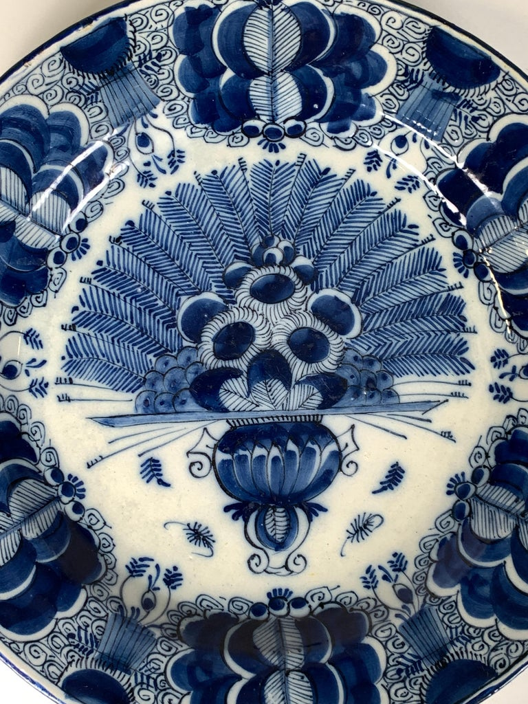 Why we love it: The intense cobalt blue We are pleased to offer this sizeable Dutch Delft blue and white charger hand-painted in deep cobalt blue. This exquisite charger was made in the 18th century, circa 1780. It shows a vase filled with