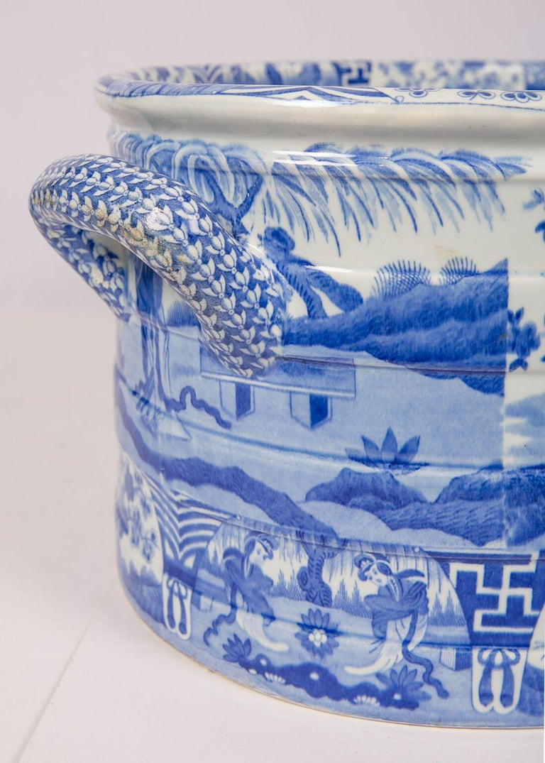 A blue and white footbath made by Spode and decorated in their