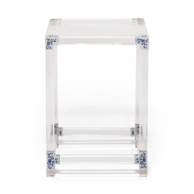 Each limited-edition blue and white invisible side table by artist July Zhou is fashioned after a traditional Ming dynasty example. Unlike other Lucite furniture that is injection molded, July's work is created by skilled artisans who heat, join,