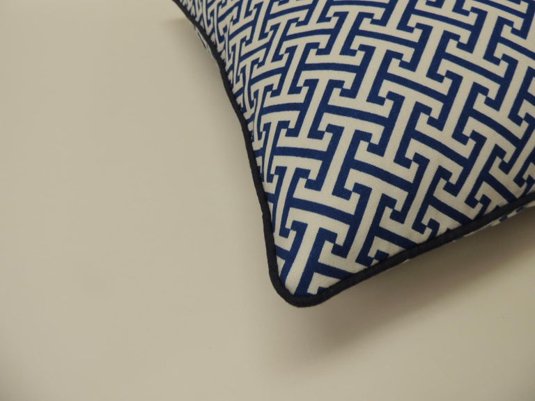 Blue and white meandering border throw pillows with ATG custom handmade navy blue linen piping all around. Double sided pillows with same fabric (front and back.) The price on the pillow includes a custom ATG feather/down insert. Invisible zipper