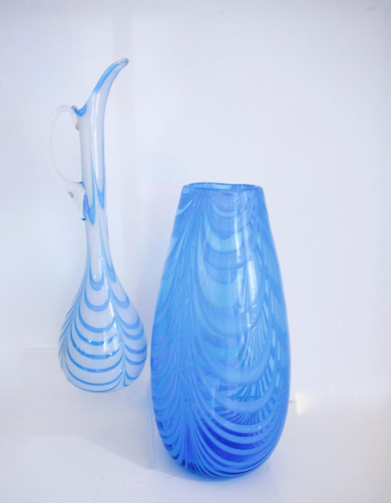 Blue and white opaline Empoli glassware Florence, pitcher and vase 1970s  Glass produced in the region of Empoli, near Florence, Italy, well known for the opaline glass created in Florence.  Pitcher height 37 cms diameter at widest 10 cms weight