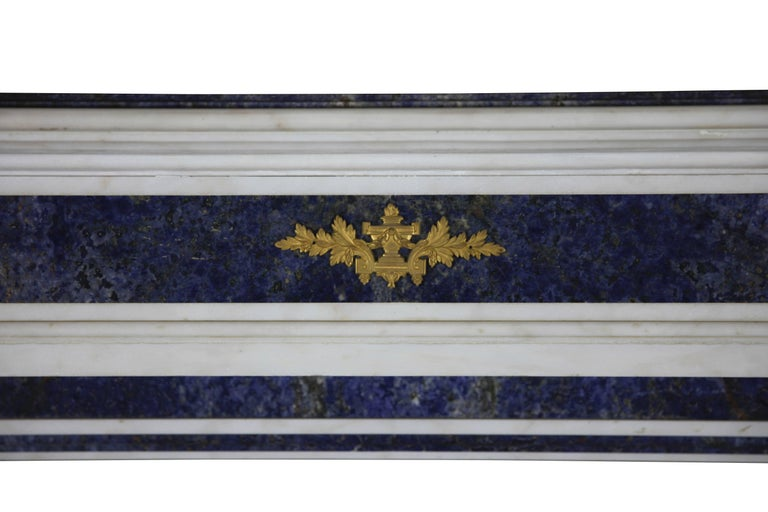 This amazing, one of a kind fireplace mantel (fireplace) is in perfect condition; it was made by special order for a Parisian salon. It is crafted from white statuary marble with Brazilian blue Baya Marble; this is a very unusual combination. It has