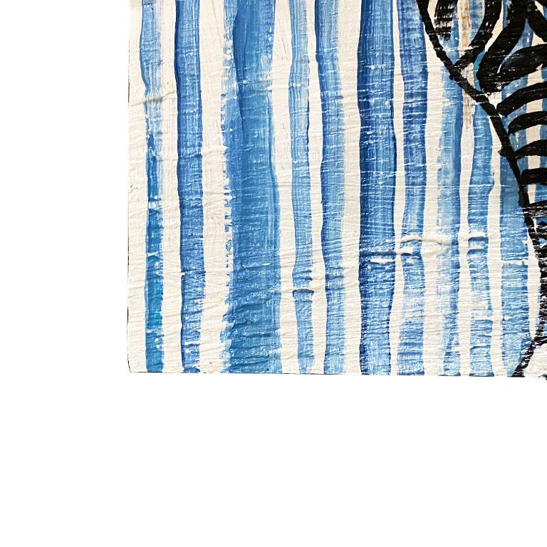A gorgeous painting of a zebra in blue and black. This piece features the outline of a zebra in black, painted on a blue and white striped background. This piece is painted on wood and is ready to hang with a hanging wire on the back.   How We