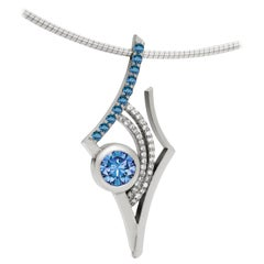 Blue and White Topaz Pendant in Sterling Silver on Snake Chain