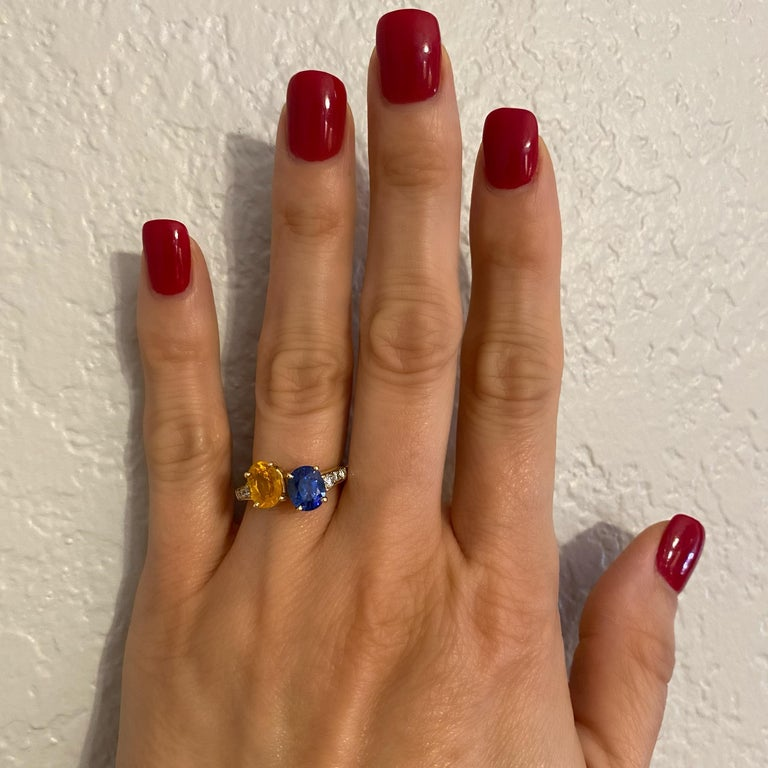 "Beautiful 'Toi et Moi' Crossover Bypass Ring. Featuring Blue and Yellow oval Sapphires, weighing approx. 4tcwt flanked on shoulders by 6 round Brilliant-cut Diamonds, approx. 0.20tcwt. Dimensions 0.82""w x 0.44""h x 0.96""d. Hand crafted in 18K yellow"
