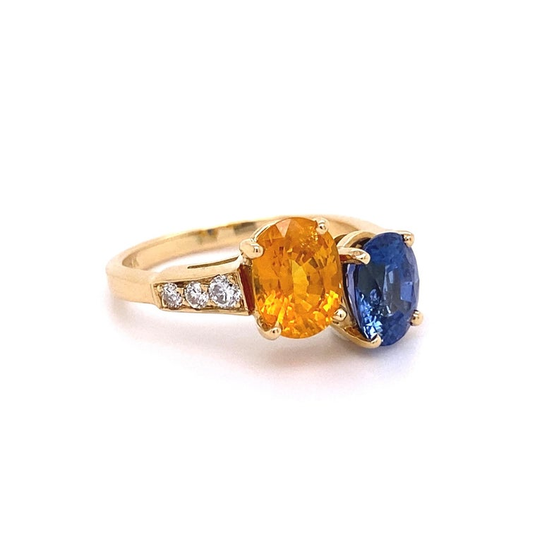Modern Blue and Yellow Sapphire Diamond Toi et Moi Gold Bypass Ring Estate Fine Jewelry For Sale