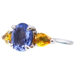 Blue and Yellow Sapphire Platinum Three-Stone Ring