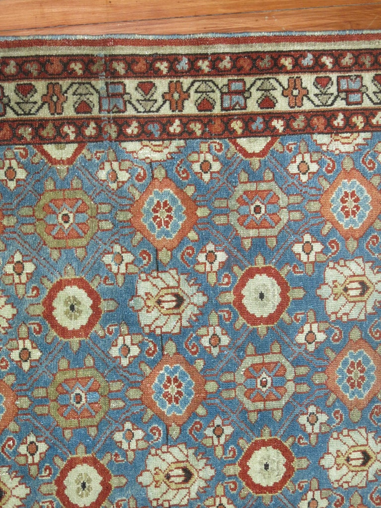 An early 20th century Persian Malayer with a primitive all over design on a blue field.
