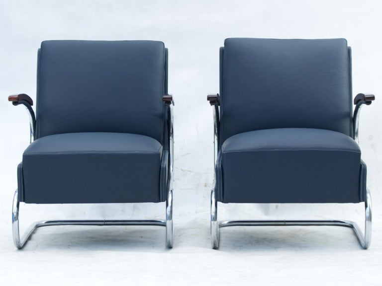 Armchairs model Fn 24 by Mücke & Melder, Czechoslovakia, circa 1930s Bauhaus period. New blue natural cow leather upholstery. Nickel-plated tubular steel construction is in a good original condition. 3 pieces available.