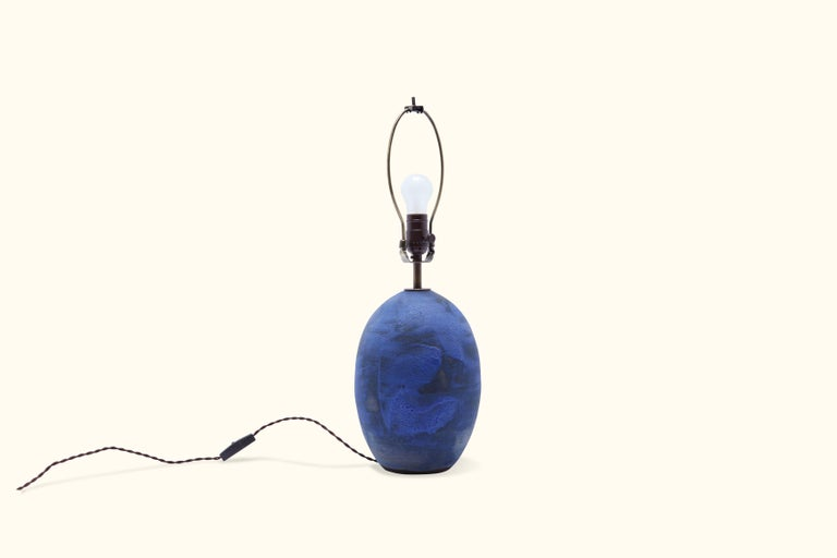 Blue black oval lamp by Victoria Morris.