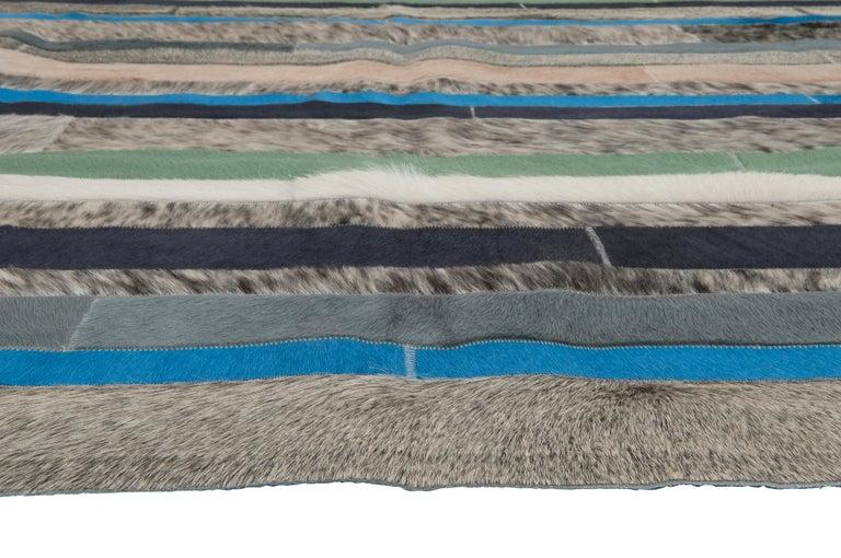 Pakistani Blue, Black & White Stripes Nueva Raya Customizable Cowhide Area Rug Large For Sale