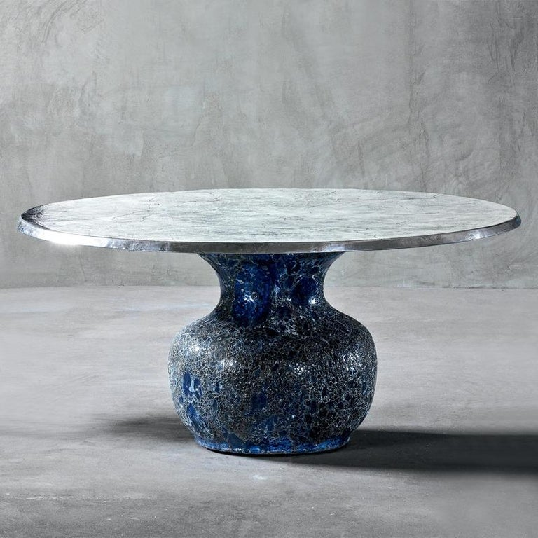 Round table blue ceramic with handcrafted blue ceramic base. Top in aluminium fusion. Available in: Diameter 160 x height 74 cm, price: 8750,00€. Diameter 130 x height 74 cm, price: 6900,00€. Also available in blue ceramic low centre table or