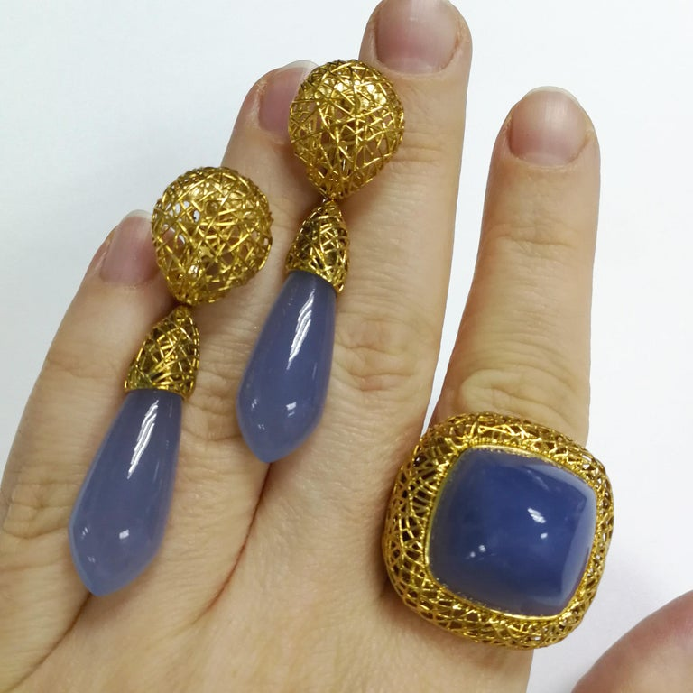 Blue Chalcedony 18 Karat Yellow Gold Rolling Stones Suite We all know about Western movies, where rolling stones are moving all the time in the desert. Our collection is inspired by this amazing plant. Thin