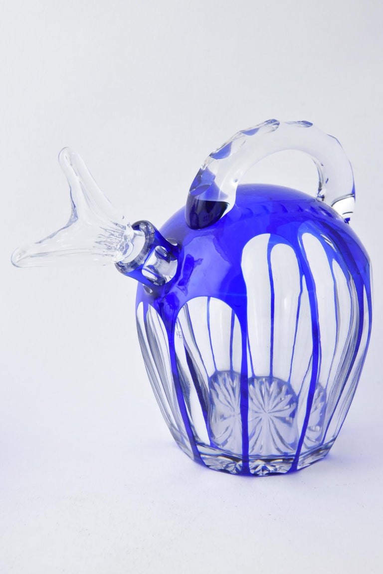 Beautiful pair of cobalt cut to clear Bohemian glass decanters with 6 matching shot or cordial glasses. This unusual form is quite striking and measures 6