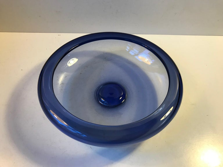 Handblown sapphire blue bowl designed by Per Lütken in 1955. This piece was manufactured at Holmegaard in Denmark during the mid-late 1960s. It is called Saphire Blue Provence and it is hand signed and numbered by the designer.