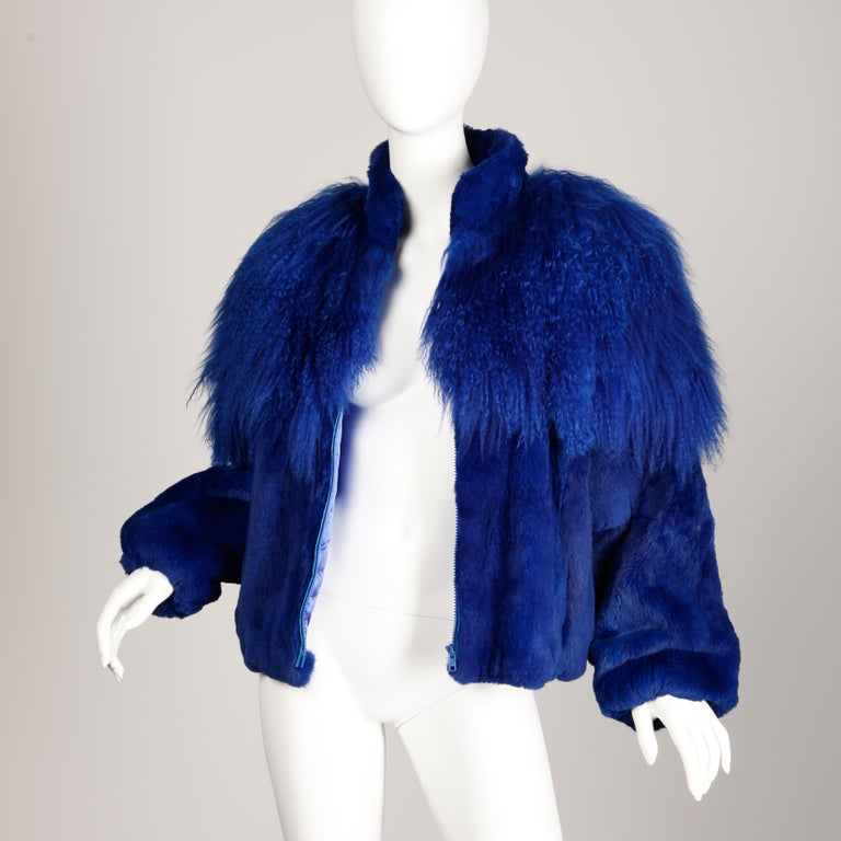 Vintage 1980s dyed cobalt blue fur bomber jacket in sheared rabbit and Mongolian lamb by Élan from the estate of Pamela Lewis (Jerry Lewis/ Gary Lewis). Fully lined with front zip closure. Elastic sleeve cuffs and waistband. The marked size is