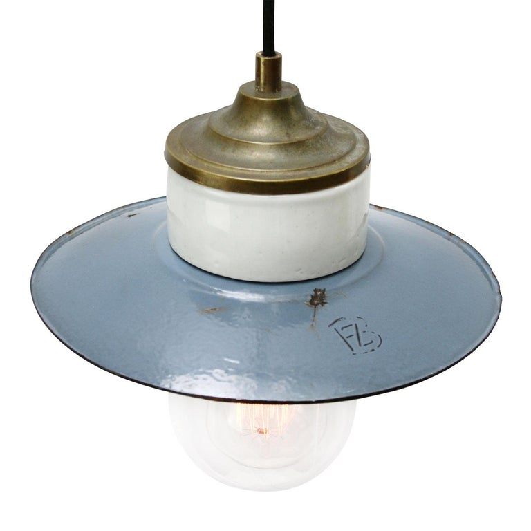 Porcelain Industrial hanging lamp. Blue porcelain, brass and clear glass. Enamel shade 2 conductors, no ground.  Weight: 1.40 kg / 3.1 lb  Priced per individual item. All lamps have been made suitable by international standards for