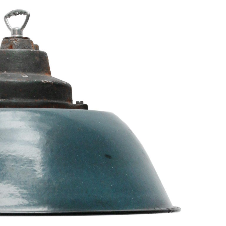Factory pendant. Blue enamel with white interior. Cast iron top.
