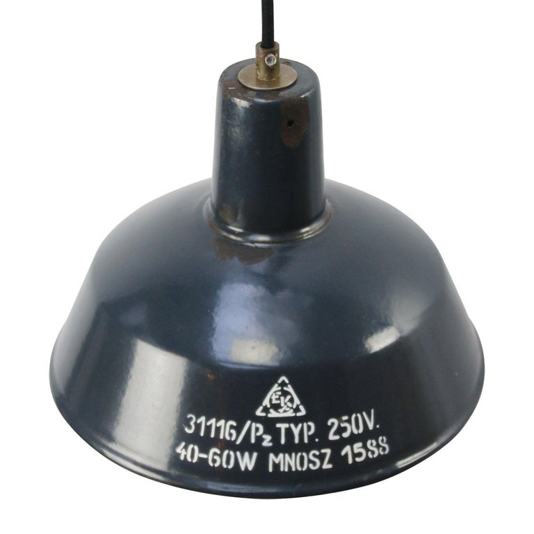 Small industrial pendant Blue enamel white interior 2 meter black cotton wire  Weight: 0.5 kg / 1.1 lb  Priced per individual item. All lamps have been made suitable by international standards for incandescent light bulbs, energy-efficient and